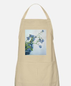 Blue flowers in blue textured vase. Apron