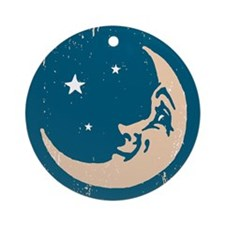 Crescent shaped moon with a face Round Ornament