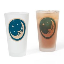 Crescent shaped moon with a face Drinking Glass