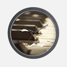 Close up of piano keys with stars. Wall Clock