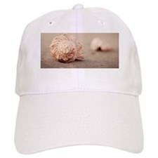 Close up of shells on beach. Baseball Cap