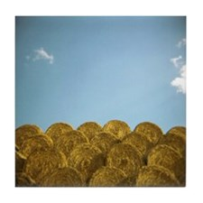circular hay bales against blue sky w Tile Coaster