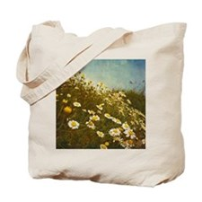 Fresh spring daisies on sand dunes in the Tote Bag