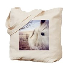 Close up of white horse eye. Tote Bag