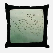 Flying flock of birds in sky by moon. Throw Pillow