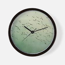 Flying flock of birds in sky by moon. Wall Clock
