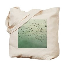 Flying flock of birds in sky by moon. Tote Bag