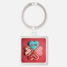 Four brightly decorated heart-shap Square Keychain