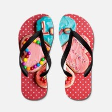 Four brightly decorated heart-shaped bu Flip Flops