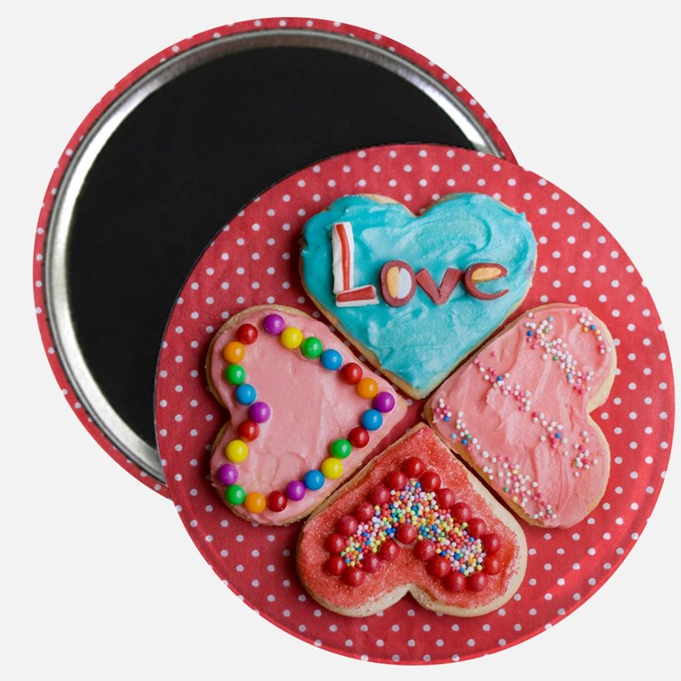 Four brightly decorated heart-shaped butter Magnet
