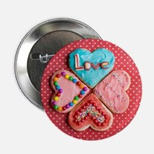 "Four brightly decorated heart-shaped  2.25"" Button"