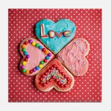 Four brightly decorated heart-shaped  Tile Coaster