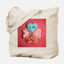 Four brightly decorated heart-shaped butt Tote Bag