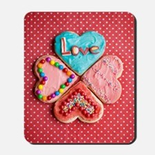 Four brightly decorated heart-shaped but Mousepad