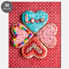 Four brightly decorated heart-shaped butter Puzzle