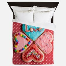 Four brightly decorated heart-shaped b Queen Duvet