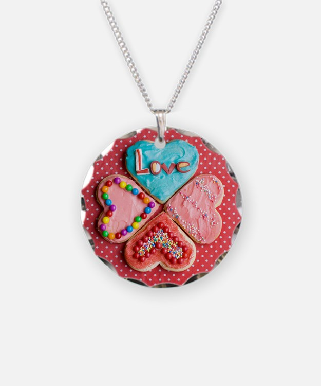 Four brightly decorated hear Necklace