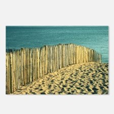 Fence in sand on beach. Postcards (Package of 8)