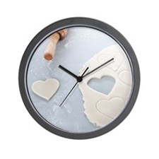 Heart shape cut out of a sheet of rolle Wall Clock