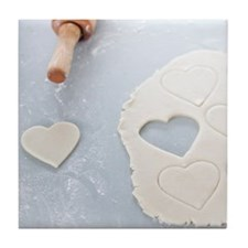 Heart shape cut out of a sheet of rol Tile Coaster
