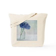 Hydrangea flower in old glass bottle. Tote Bag