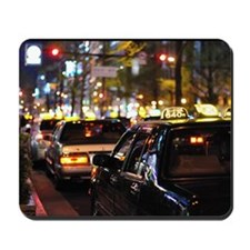 Many taxis line up on the street at nigh Mousepad