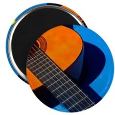 Guitar and its plectrum on a blue table. Magnet