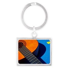 Guitar and its plectrum on a bl Landscape Keychain