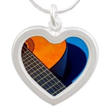 Guitar and its plectrum on a Silver Heart Necklace