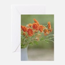 Orange flowers in white pitcher. Greeting Card