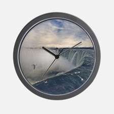 Seagull flying over misty Horseshoe Fal Wall Clock