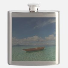 Small boat floating on the clear shallows of Flask