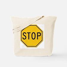 yellow stop sign Tote Bag