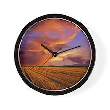 Sunset on recently cut field. Wall Clock