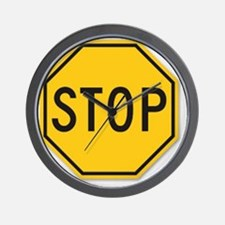 yellow stop sign Wall Clock
