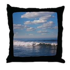 Surfer riding big wave in Ocean beach Throw Pillow
