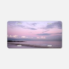 Serene coastal scene at dus Aluminum License Plate