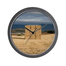 Square haystack during sunset, Navarre  Wall Clock
