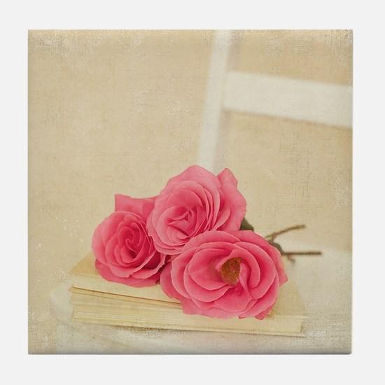 Three pink rose stems laying on cream Tile Coaster