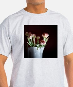 White vase with flowers. T-Shirt