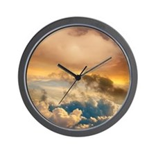 Sunset viewed from 30,000 feet in a con Wall Clock