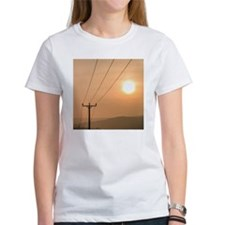 Telephone wires and pole with suns Tee