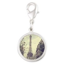 The Eiffel tower surrounded by Silver Round Charm