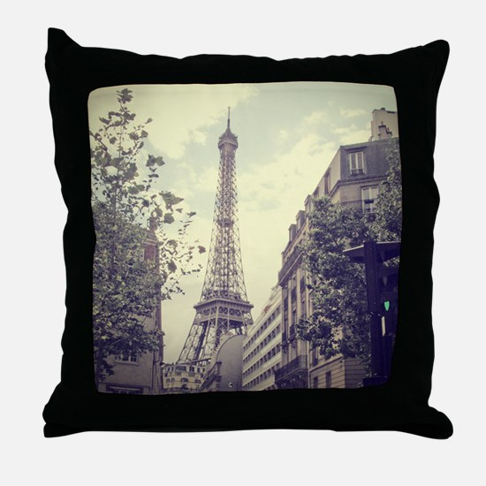 The Eiffel tower surrounded by the st Throw Pillow