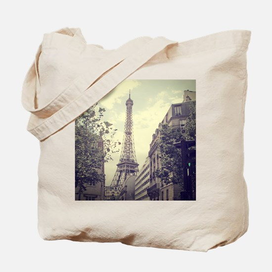 The Eiffel tower surrounded by the street Tote Bag