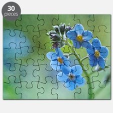 Tiny blue forget-me-not flowers. Puzzle