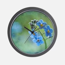 Tiny blue forget-me-not flowers. Wall Clock