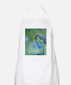 Tiny blue forget-me-not flowers. Apron