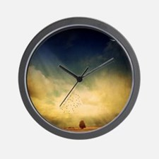 The trees, birds and light play in the  Wall Clock