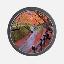 Trees with autumn colors along bending  Wall Clock